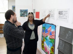 Artist Faith Ringgold and Curlee Raven Holton discussing prints in the studio.